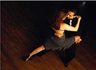 a couple dancing in a ballroom